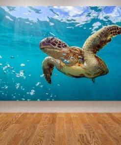 Photo de tortue de mer géante qui nage paisiblement et des bulles qui s'échappent