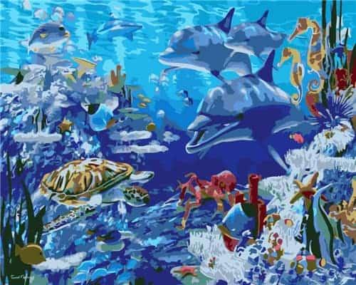 Plusieurs dauphins et une tortue