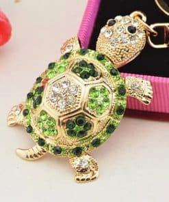 bijoux tortue sertie en vert