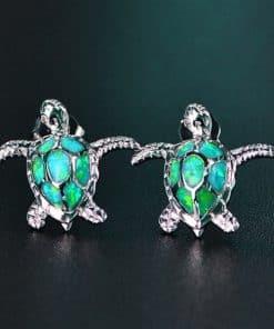 deux tortues de mer en argent 925 cristal vert