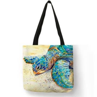 dessin d'un animal marin sur la plage imprimé sur sac